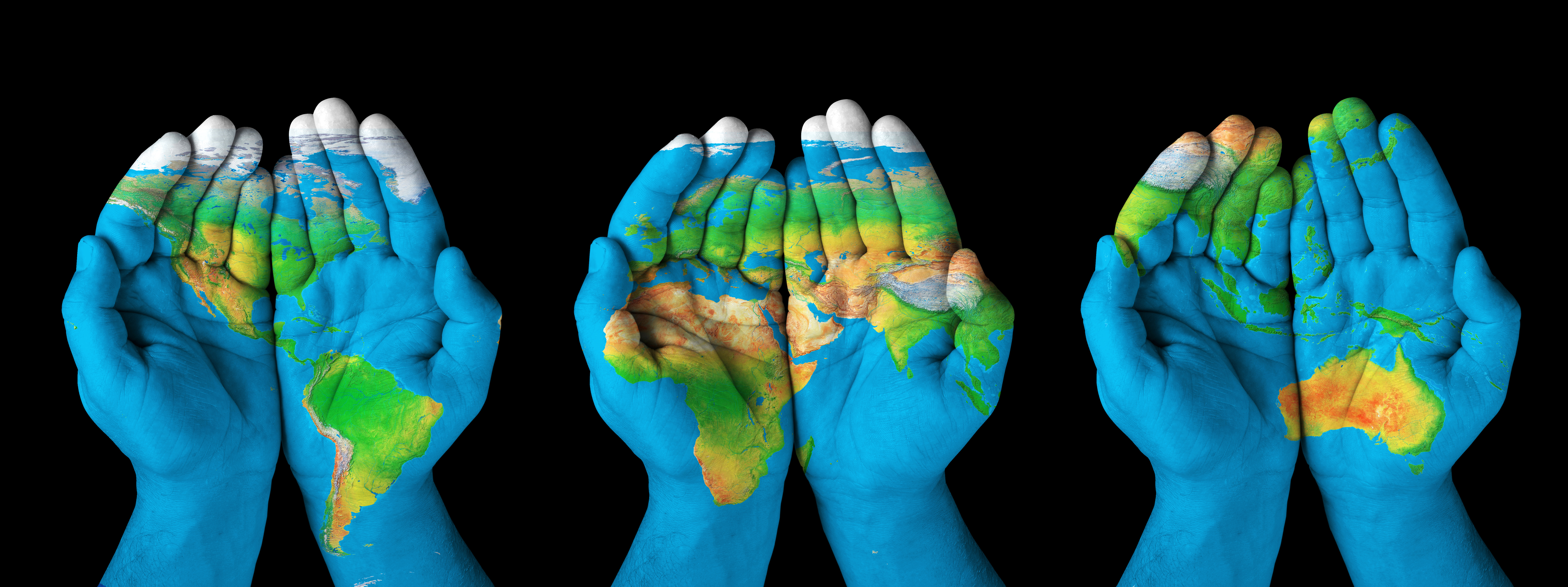World Map On Hands.Human Analytics Map Painted On Hands Concept Of Having The World